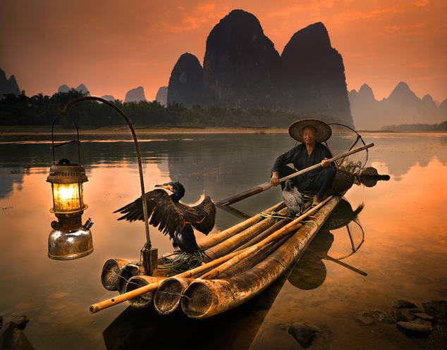 Guilin, un pêcheur avec son cormoran