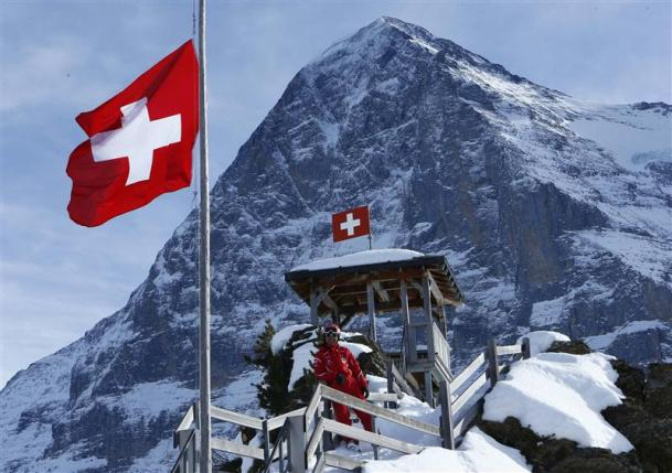 Chinese ski instructor Xu poses on the Kleine Scheidegg in front of the Eiger north face in the ski resort of the Jungfrau region