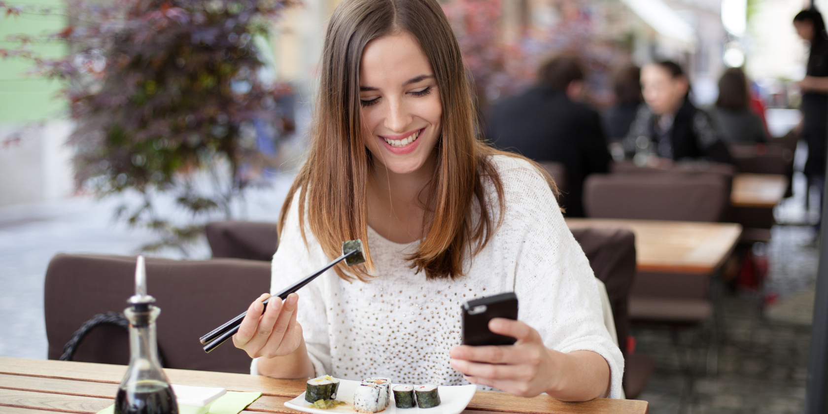woman-chopsticks-phone
