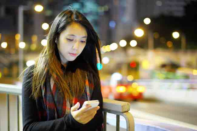 woman using mobile at night